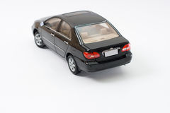 Model Toyota Corolla. Rear view of black Toyota Corolla miniature replica with shadow isolated on white background Stock Photography