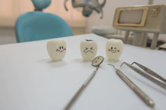 Model toys teeth and equipment in Dental room background. Stock Image