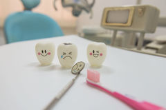 Model toys teeth and equipment in Dental room background. Royalty Free Stock Images
