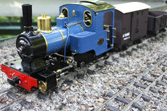 Model Train. Blue model train sat on tracks of a model railway set royalty free stock photography