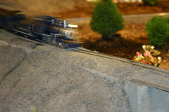Model Train. Model railroad train in motion on set royalty free stock photography
