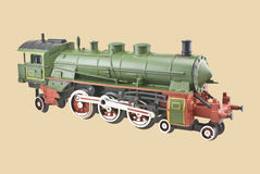 Train Locomotive. Model train locomotive isolated on beige background stock photos