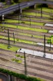 Model train rails next to the railroad station Royalty Free Stock Images