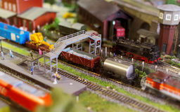 Model of train on railstation. Royalty Free Stock Image