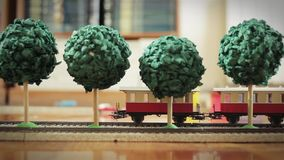 Model Train Running. Model Train and Trees running in the floor stock video