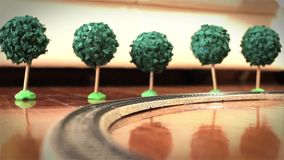 Model Train and Trees. Running in the floor stock video footage