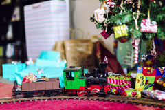 Model train with Xmas tree and gifts Royalty Free Stock Image