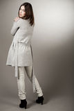 Model turning back with her spring coat Stock Photography