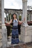 Asian Model Standing Between Two Columns at Medieval Site. A young Asian woman stands between two columns at a medieval architectural structure Royalty Free Stock Photography