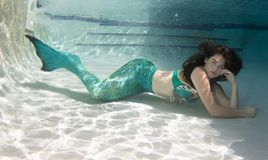 Model underwater in a pool wearing a mermaids tail. Stock Photography