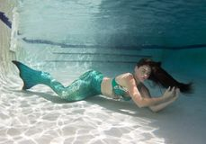 Model underwater in a pool wearing a mermaids tail. Stock Photo