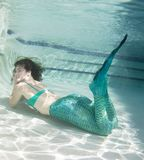 Model underwater in a pool wearing a mermaids tail. Royalty Free Stock Photos