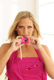 Model Using Pink Toy Camera Stock Image