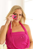 Model Using Pink Toy Camera Stock Photo