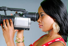 Model using video camera Royalty Free Stock Photos