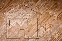 Model van het huis op het laminaat Royalty-vrije Stock Afbeeldingen