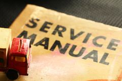Model Vehicle Scene Put On The Old Service Book. Royalty Free Stock Images