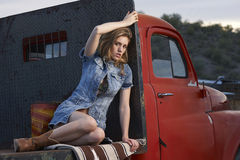 Model On Vintage Truck Stock Photo