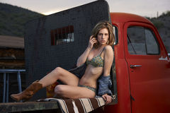 Model On Vintage Truck Stock Image