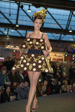 Model walking with chocolate dress during fashion show Royalty Free Stock Image