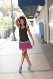 Model walking down the street Stock Photos