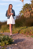 Model walking on foot path Royalty Free Stock Images