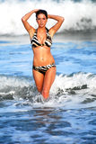 Model walking out of the ocean Royalty Free Stock Photo