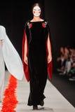 A model walks on the DIMANEU catwalk Royalty Free Stock Photo