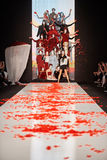 A model walks on the DIMANEU catwalk Royalty Free Stock Photos