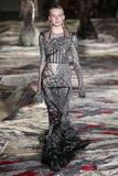 A model walks the runway during the Alexander McQueen designed by Sarah Burton show as part of the Paris Fashion Week Royalty Free Stock Photography