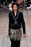 A model walks the runway during the Alexander McQueen show Stock Photos