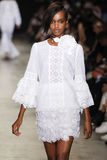 A model walks the runway during the Andrew GN show as part of the Paris Fashion Week. PARIS, FRANCE - SEPTEMBER 30: A model walks the runway during the Andrew GN royalty free stock photo