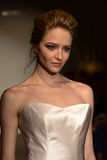 A model walks the runway at the Anna Mayer Spring 2015 Bridal show Stock Photography