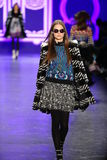 A model walks the runway at the Anna Sui Fall 2016 show. NEW YORK, NY - FEBRUARY 17: A model walks the runway at the Anna Sui Fall 2016 show during New York Royalty Free Stock Photo