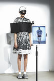 A model walks the runway during the Anrealage show as part of the Paris Fashion Week Stock Photos