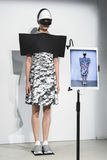 A model walks the runway during the Anrealage show as part of the Paris Fashion Week Royalty Free Stock Photo