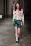 A model walks the runway during the Arthur Arbesser fashion show Stock Photos