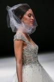 A model walks runway at Badgley Mischka fashion show during Fall 2015 Bridal Collection Stock Images
