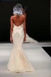 A model walks runway at Badgley Mischka fashion show during Fall 2015 Bridal Collection Stock Photos