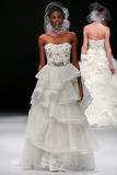 A model walks runway at Badgley Mischka fashion show during Fall 2015 Bridal Collection Stock Photography