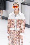 A model walks the runway during the Chanel show Stock Photos
