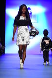 A model walks the runway at the Comme Tu Es fashion show Stock Photos