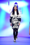 A model walks the runway at the Comme Tu Es fashion show Stock Image