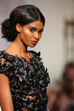 A model walks the runway at the Crisbery's fashion show during Spring 2016 Royalty Free Stock Photos