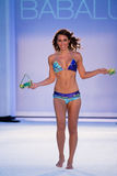A model walks runway in designer swim apparel during Babalu - Protela Colombian Brands fashion show Royalty Free Stock Photography