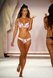 A model walks runway in designer swim apparel during the Frankies Bikinis fashion show. MIAMI, FL - JULY 18: A model walks runway in designer swim apparel during stock photos