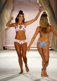 A model walks runway in designer swim apparel during the Frankies Bikinis fashion show. MIAMI, FL - JULY 18: A model walks runway in designer swim apparel during royalty free stock photos
