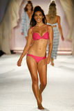 A model walks runway in designer swim apparel during the Frankies Bikinis fashion show. MIAMI, FL - JULY 18: A model walks runway in designer swim apparel during royalty free stock images