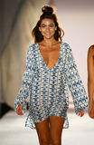A model walks runway in designer swim apparel during the Frankies Bikinis fashion show. MIAMI, FL - JULY 18: A model walks runway in designer swim apparel during stock photography