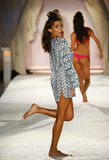 A model walks runway in designer swim apparel during the Frankies Bikinis fashion show. MIAMI, FL - JULY 18: A model walks runway in designer swim apparel during royalty free stock photo